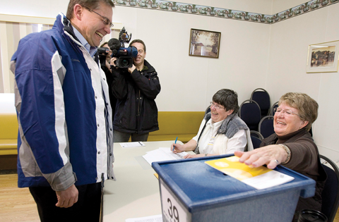 Premier Ed Stelmach shares a laugh with Elections Alberta staff as he casts his ballot in Andrew, March 3, 2008.