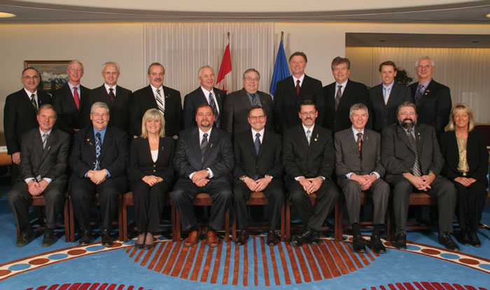 "Ed Stelmach's first cabinet: ""A bunch of rural white guys."" His second cabinet, announced March 12, ""shortchange[s]...the major cities."""