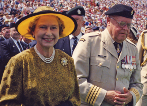 Queen Elizabeth II reviewing the troops, accompanied by Major General Howard, Calgary, 1990.
