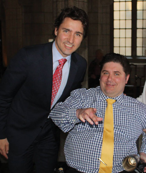 With federal Liberal leader Justin Trudeau, 2013.