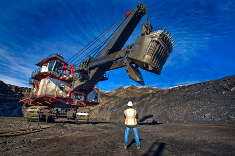 Worker at an open-pit coal mine near Hinton.