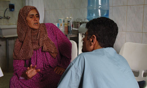 Dr. Saren Azer speaks with a patient in a rural clinic in Kurdistan.