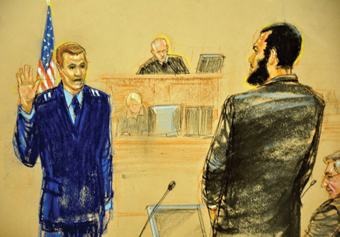 Captain Michael Grant, United States Air Force, swears in the now 23-year-old Khadr during his trial.